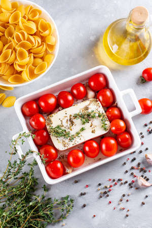 Baked feta pasta. Feta cheese and tomatoes in chilli and garlic oil. In the oven it turns into an amazing pasta sauce by itself. Just add some cooked pasta, mix and enjoy.