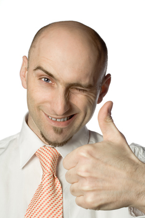 Balding man gives the thumbs up sign while winking Stock Photo - 1498120