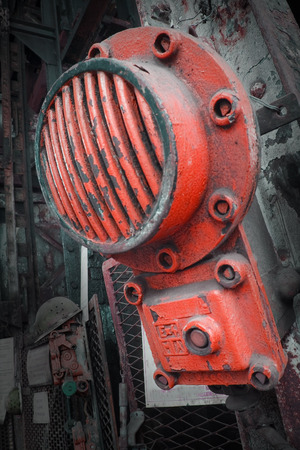 bolted: A red attachment bolted to a piece of heavy machinery.