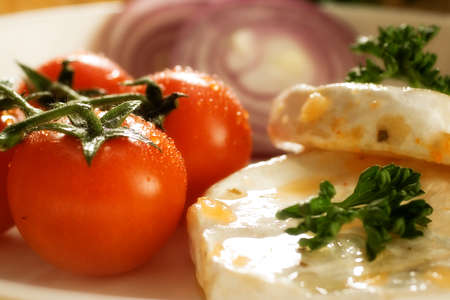 tantalizing: Closeup of snack of cherry tomatoes and cheese.