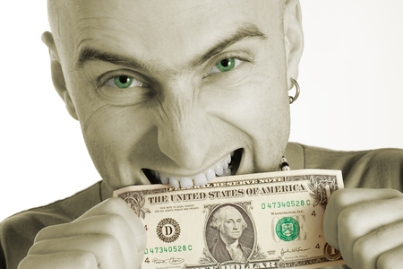 nibble: Man with earring biting a dollar bill. Photo colorized green in mans eyes and green on dollar bill.  Stock Photo