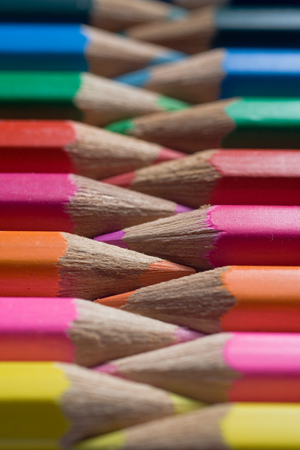 alternating: Colored pencils lined in a row, alternating point to point.  Stock Photo