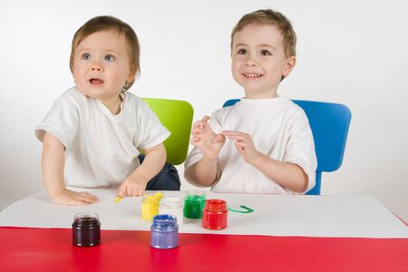 litlle boy and girl enjoy painting with colours Stock Photo - 4496393
