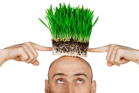 Man with a patch of green grass on his head.  Isolated against a white background. photo