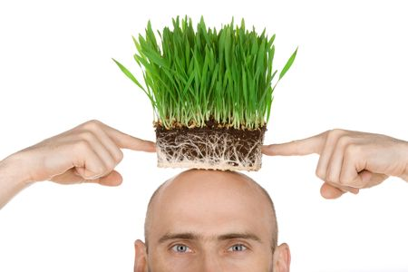Man with a patch of green grass on his head.  Isolated against a white background. Stock Photo - 6266497