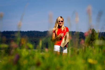 An active young woman outside in the countryside. Stock Photo - 9526658