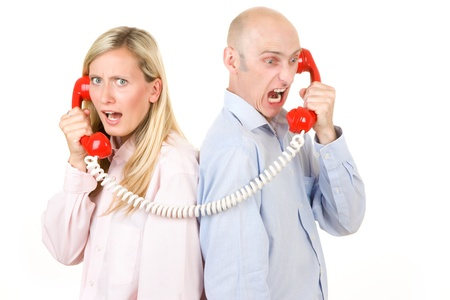 Man and woman on connected telephone isolated on white. Stock Photo - 9526318
