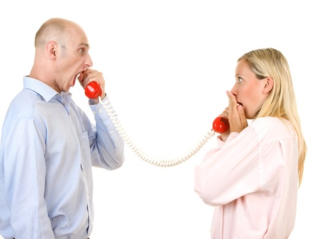 Man yelling at woman on telephone isolated against a white background. Stock Photo - 9526312