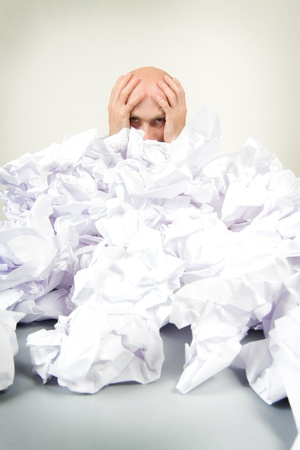 overwhelm: A stressed man holding his head. Stock Photo