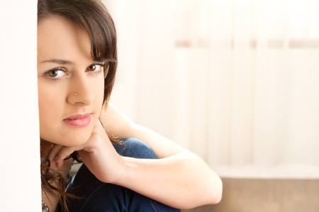 Portrait of attractive female teenager indoors with background copy space. Stock Photo - 9526573