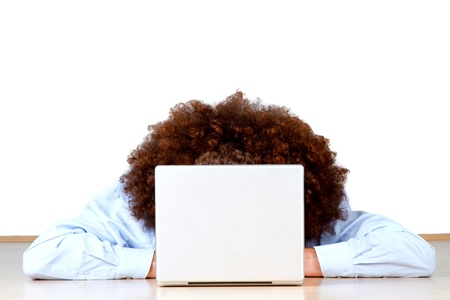 frizzy: Long frizzy or afro style hair of person working on open laptop computer; white studio background.