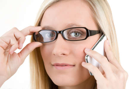 Portrait of blond teenager with mobile telephone and glasses on forehead, isolated on white background. Stock Photo - 9575468