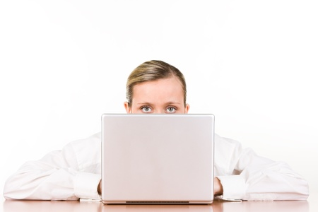 obscured: Portrait of partially obscured young businesswoman with laptop computer, white studio background.