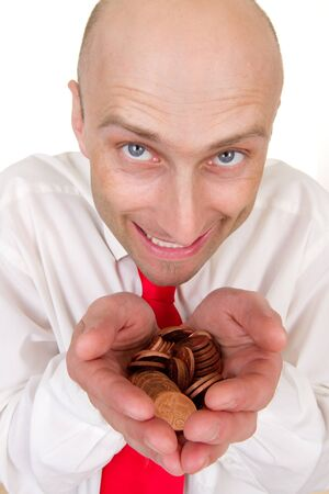 Portrait of smiling bald headed businessman with pile of change in hands, isolated on white background. photo