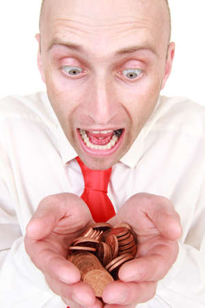 Portrait of shocked young businessman with pile of coins or money, isolated on white background. Stock Photo - 9575532