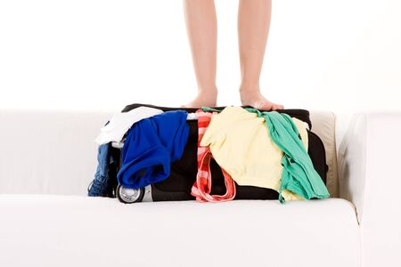 unpacked: A metaphorical image of a woman standing on a overflowing holiday bag.