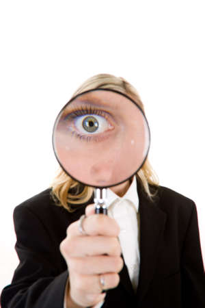 A woman with a magnifying glass over her eye.  photo