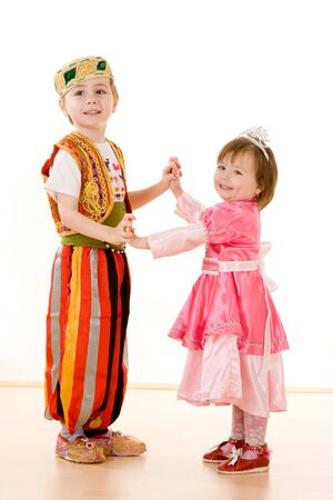 Young children dressed up for celebration. photo