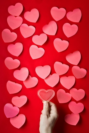 Mass of red post-it papers shaped like Valentine�s hearts Stock Photo