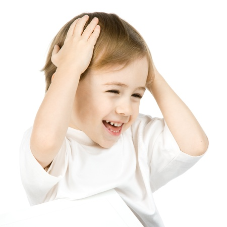 holding head: Portrait of cute smiling boy holding hands on head, isolated on white background.