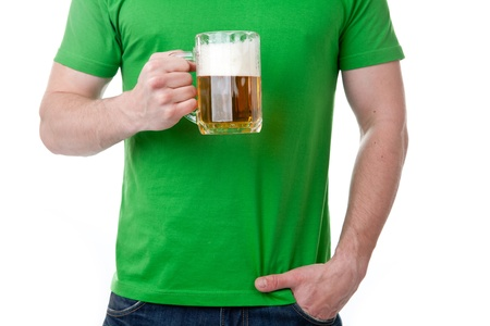Body of man with half drunk glass or pint of beer; isolated on white background. photo