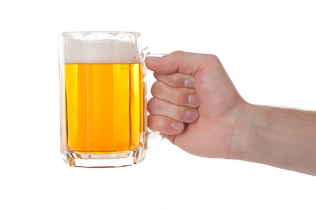 pint: Side view of hand with glass or stein full of beer or lager; isolated on white background. Stock Photo