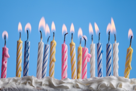 beautiful birthday candles on blue background  Standard-Bild