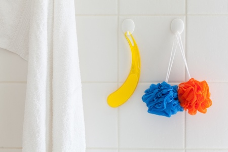 scrubbers: Washcloths and white towel in a bathroom shower. Stock Photo