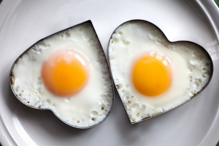 cholesterol: Fried egg on heart-shaped .