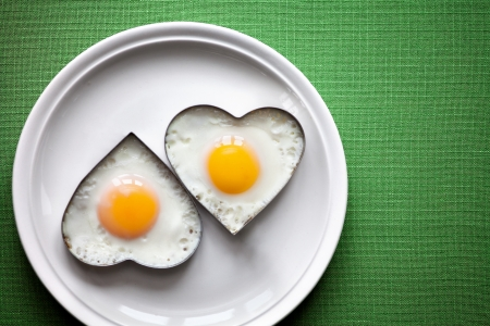 Fried egg on heart-shaped .
