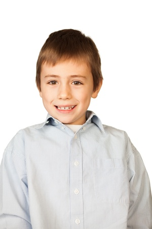 bonnie: Portrait of cute young boy seated at table smiling, isolated on white background