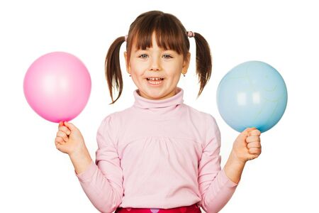 Portrait of happy woman with blue and pink balloons, white background  photo