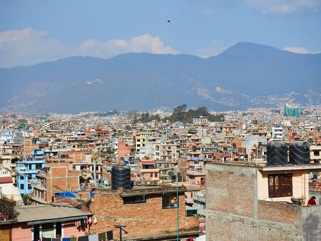 View of the streets, houses and the surrounding hills of Kathmandu, between the tourist district of Thamel and the Swayambhu stupa