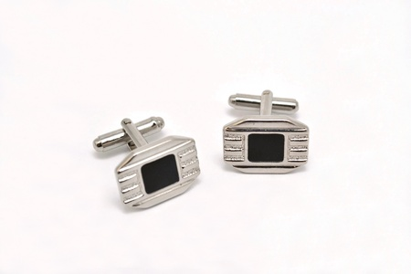 cuff buckle: shining studs on a white background
