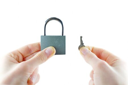 lock and key: Opened lock and key in hand door