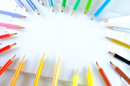 colored school: Color pencils and notebook