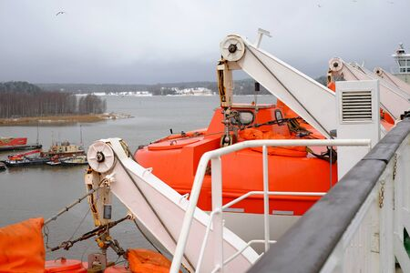 boat accident: Lifeboats on the ship cruise, rescue sea boat orange