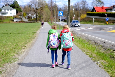 home: Two schoolgirls go home people, female girl, Stock Photo