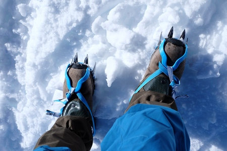 crampon: Boots with crampons mountain, boot climber crampon Stock Photo