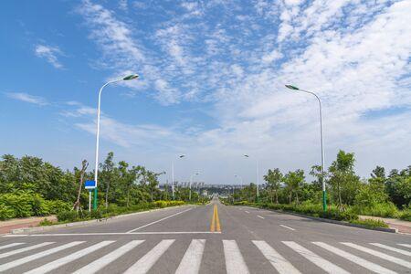 Blue sky and asphalt road