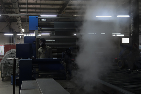 dhaka: This is a photo of a dying machine operator in a dying mill. Which is situated in Dhaka, Bangladesh. Editorial