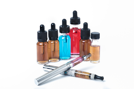 Two electronic cigarettes with glass e-liquid bottles on white background