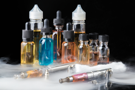 Collection of vape equipment with smoke Stock Photo