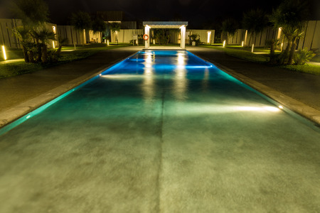 Luxurious swimming pool in tropical resort Editorial