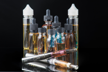 Collection of electronic cigarette equipment with smoke Stock Photo