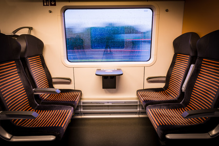 Inside modern train looking out of the window