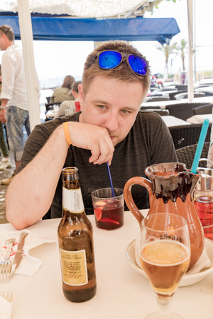 Man drinking sangria and reminiscing Stock Photo