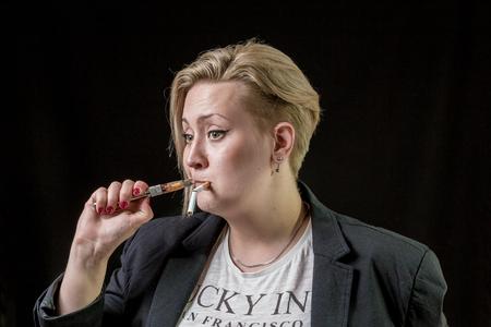 Girl tries to smoke new modern electronic cigarette