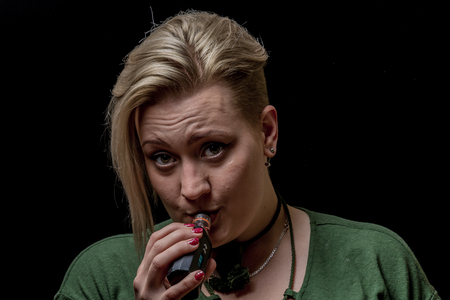 Woman inhaling from electronic cigarette Stock Photo