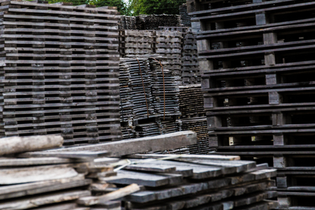 Piled of old and gray timber planks Stock Photo